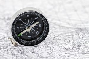 38748454 - compass lying on a black and white map