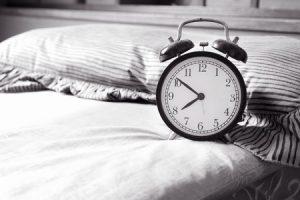 40342755 - alarm clock on bed at home alarm clock
